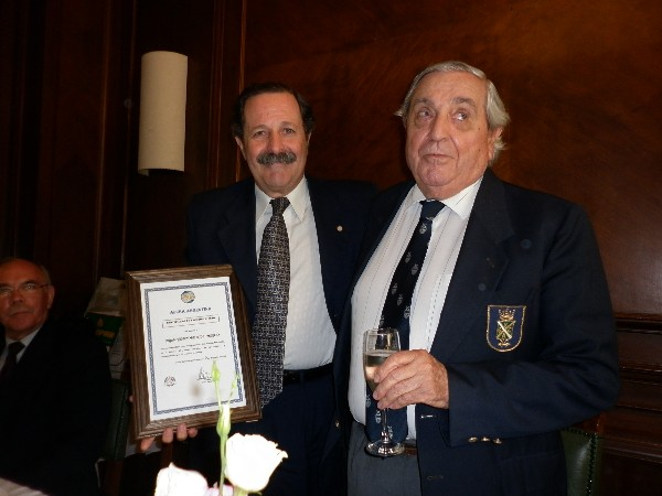 In December, Rear Adm. Emilio Nigoul, ARA (Ret.) (r), chapter president, presents a farewell certificate to Maj. Gen. Norberto Dimeglio, FAA (Ret.), chapter first vice president, who resigned for personal reasons.