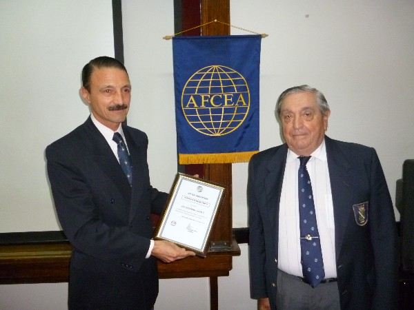 In September, Col. Elejandro Echazu, EA, former Army University director, receives a certificate from Adm. Nigoul recognizing the university�s continued collaboration with the chapter.