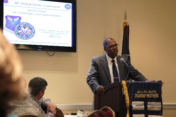Arthur G. Hatcher Jr., director of communications for Air Force Global Strike Command, addresses the chapter at its monthly membership luncheon in March.
