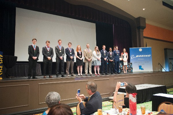 Eleven high school seniors receive scholarships at the chapter's April banquet in Bossier City, Louisiana.