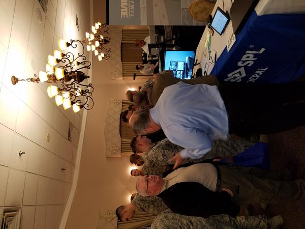 Personnel from Barksdale Air Force Base, Louisiana, visit booths at the sixth annual Technology Exposition in March.
