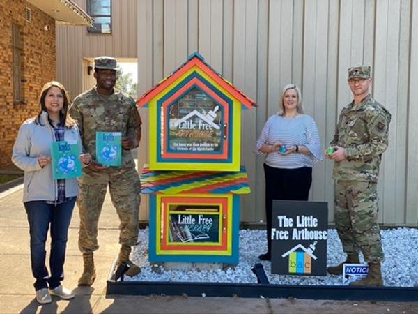Posing for a photo at the Little Free Arthouse in November are (l to r) Brandi Pickett, chapter secretary; Capt. Kebin Umodu, USAF, chapter vice president; Robin Jones, director, Bossier Arts Council; and Lt. Col. Michael Harris, USAF, chapter president.