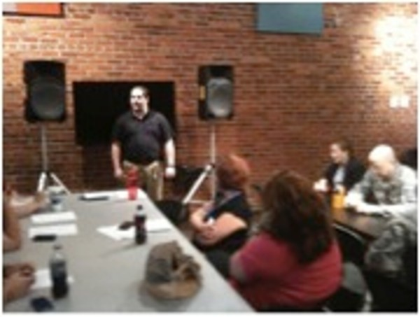 Robert Bills, Ohms Systems Incorporated, speaks to government and industry information technology professionals while demonstrating social engineering tactics at the chapter�s Continuing Education Lunch and Learn in August.