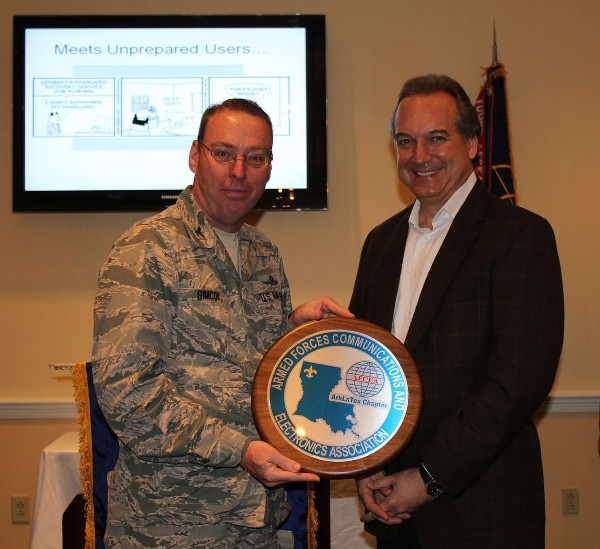 Col. Frank Simcox, USAF, chapter president, presents Glenn Gramling, vice president of sales and business development at Cenzic Security, with a chapter plaque in appreciation for his speech to the chapter in April.