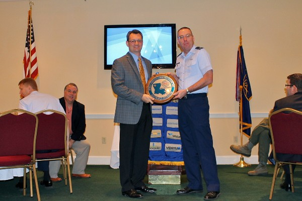 Col. Frank Simcox, USAF, chapter president, presents Brian Vandegrift, executive vice president of Venyu, with a chapter plaque in appreciation for his speech to the March luncheon crowd.