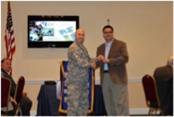 Lt. Col. Curtis Juell, USAF, chapter president, thanks John Miralles of Louisiana State University Shreveport for his presentation to the chapter at its August luncheon.