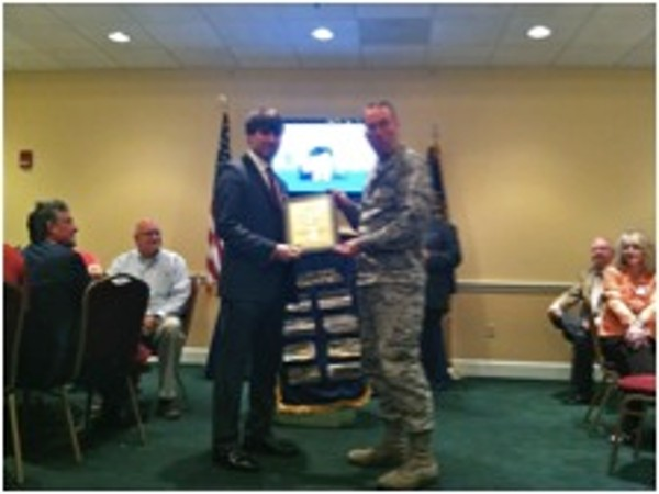 In September, Col. Frank Simcox, USAF, chapter president, thanks guest speaker Michael Marshall of Logic Nation and presents a certificate recognizing the company as an AFCEA Corporate Small Business Partner.