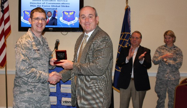 In March, Dean Fox (r), Texas regional vice president, thanks Lt. Timothy Hoffman, USAF, for his significant contributions to AFCEA and his community, which earned him distinction as the region's Young AFCEAN of the Year.