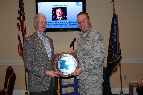 Col. Frank Simcox, USAF, chapter president, presents Gen. Closner with a chapter plaque in appreciation for his speech to the chapter in January. Photo courtesy of Jill Macchiaverna.