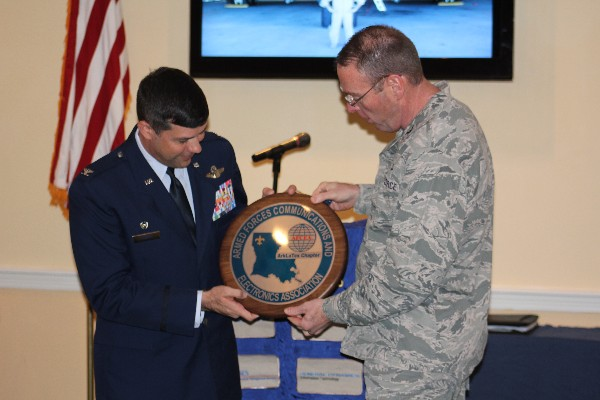 Col. Frank Simcox, USAF (r), chapter president, presents Col. Gebara with an honorary chapter �coin� in appreciation for his speech to the chapter in November.