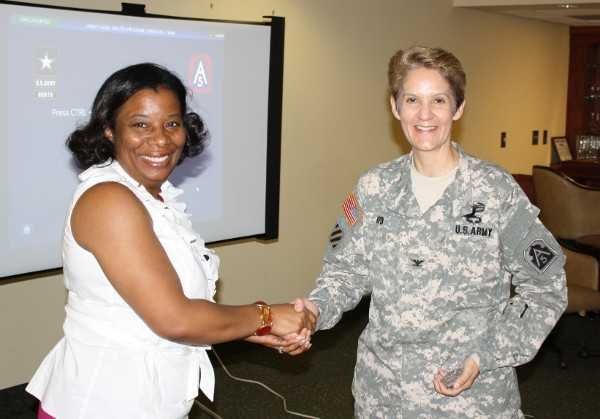 Chapter President Michelle Brown (l) thanks Col. Jan Apo, USA, defense coordinating officer, Federal Emergency Management Agency Region IV, for her outstanding presentation and vehicle tour in May.