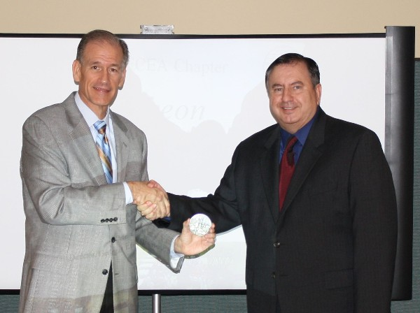 David Landry (r), chapter second vice president, presents Charley English, director of the Georgia Emergency Management Agency, with a token of appreciation at the September meeting.