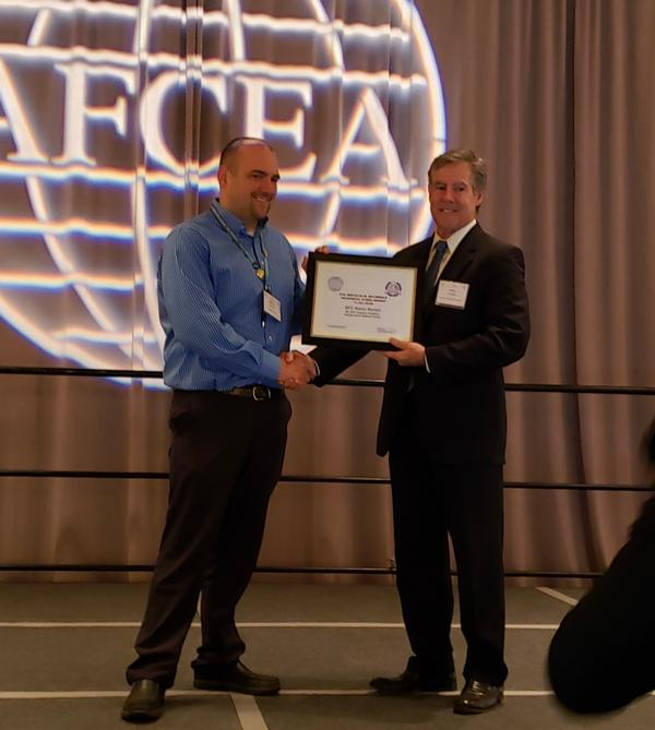 Sgt. First Class Kevin Kinzer, ANG, receives the Lt. Gen. Douglas Buchholz Scholarship from Bob Damen, past chapter president, during the AFCEA Cyber, Education, Research and Training Symposium (CERTS) in Augusta, Georgia, in January.