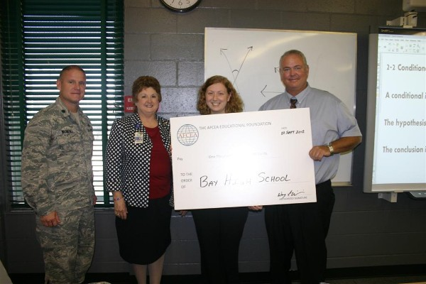 In September, Lt. Col. Wayne Wisneski, USAF (l), chapter president, presents a Science Teaching Tools grant to Morgan Sansbury (2nd from r) of Bay High School while Sandra Davis, assistant superintendent for Bay County schools, and Billy May, Bay High School principal, look on.