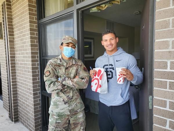 In May, Staff Sgt. Kristian Hoffman-Martinez, USAF, chapter vice president of membership, spreads the news about AFCEA as he passes over a delicious lunch.