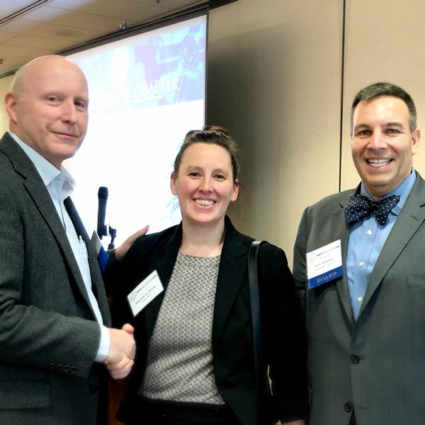 Chapter President Bill Jones (l) and Vice President of Small Business Eric Strauss welcome Stephanie Shutt, director, General Service Administration's Multiple Award Schedule Program Management Office, at the March meeting.