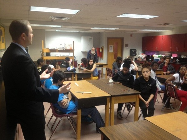 BELVOIR— In June, Young AFCEAN Andrew Renken talks of the importance of science, technology, engineering, and mathematics to students at Walt Whitman Middle School.