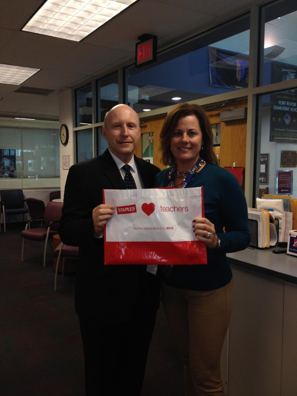 Bill Jones, chapter president, presents Nancy Rowland, STEM coordinator at Fort Belvoir Elementary School, with 100 $50 gift cards for teachers at the school in October.