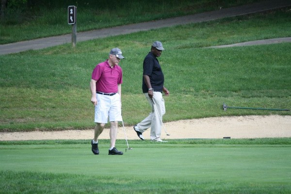 Bill Jones (l), chapter president, and Alvie Johnson, chapter executive vice president, strategize for the winning putt during the chapter�s fundraising golf tournament in May.