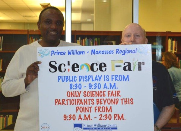 Alvie Johnson (l), chapter executive vice president, and Jones show their support for the Prince William County Science Fair in March.