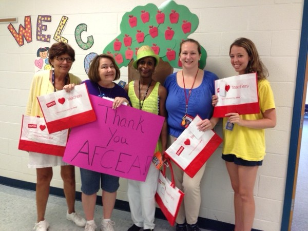 In October, happy teachers at Fort Belvoir Elementary School thank the chapter for the gift cards it presented to kick off the school year.