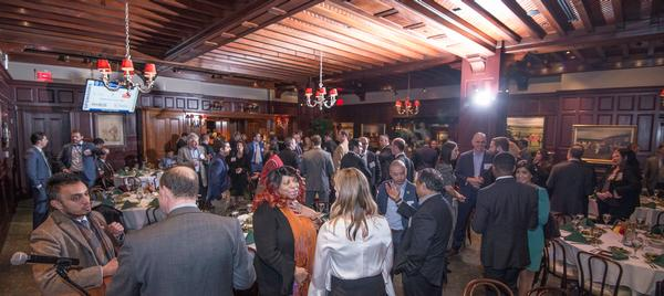 Winter IT Luncheon attendees network at a reception before the seventh annual event in March.