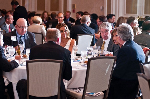Attendees gather for a collaborative roundtable discussion during the Senior Government Executive Dinner in July.