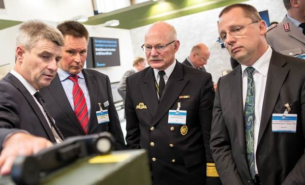 Rear Adm. Wolfgang Bremer (2nd from r), deputy director for equipment, information technology and in-service support, joins Dr. Dietmar Theis, information technology director of the German Armed Forces (r), to visit exhibitors at the Bonn Tech Expo.