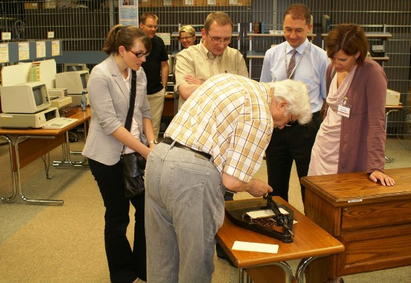 Young AFCEANs in Germany have the chance to see a Hollerith punch card machine during a joint day trip to the IBM Lab and Museum in June. The Hollerith is said to be the first data processing machine.