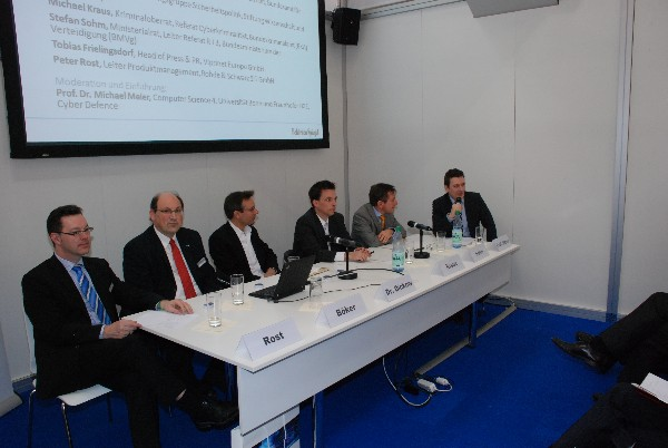 Experts from federal agencies and ministries discuss organized cybercrime and espionage in Hannover, Germany, in March.
