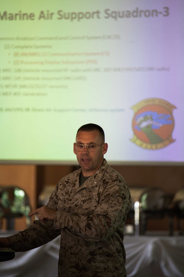 Guest speaker Lt. Col. John Lewis, USMC, speaks on the Marine Air Command and Control Systems in May.