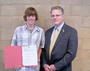 In June, Mark Witzel (r), chapter president, presents a $1,000 scholarship to Derek Bosman, High Tech High School, North San Diego County. Bosman will study mechanical engineering at California State University-Fullerton.