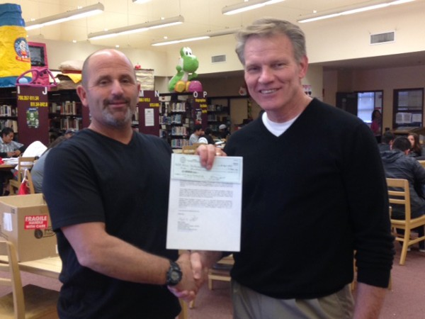 Alan Saltamachio, Fallbrook High School biology teacher (l), accepts a $500 Science Teaching Tools grant and congratulatory letter from Chapter President Mark Witzel at the April luncheon.