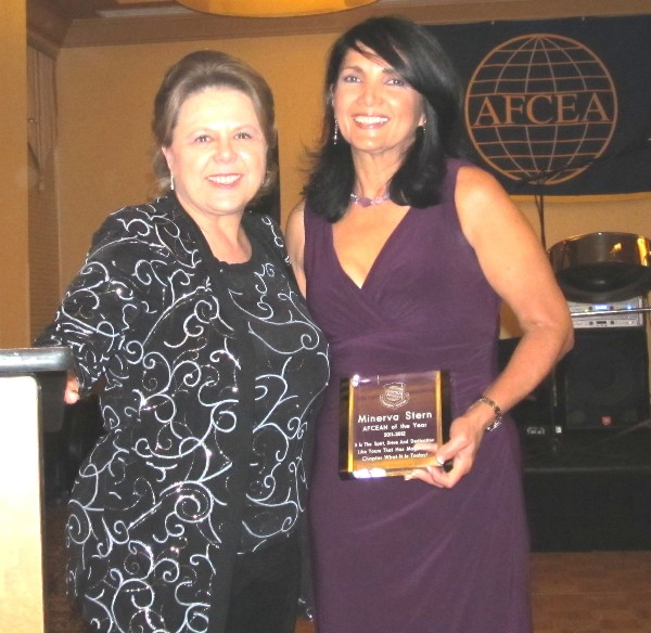 Glore (l), mistress of ceremonies for the October banquet, presents Stern with a plaque recognizing her as the chapter's AFCEAN of the Year for her exceptional performance.