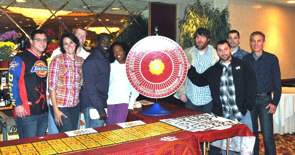 Volunteers assist with the Northrop Grumman-sponsored flower and beverage wheel at the chapter�s Bull & Oyster Roast in November, which raise more than $40,000 in scholarship funds.