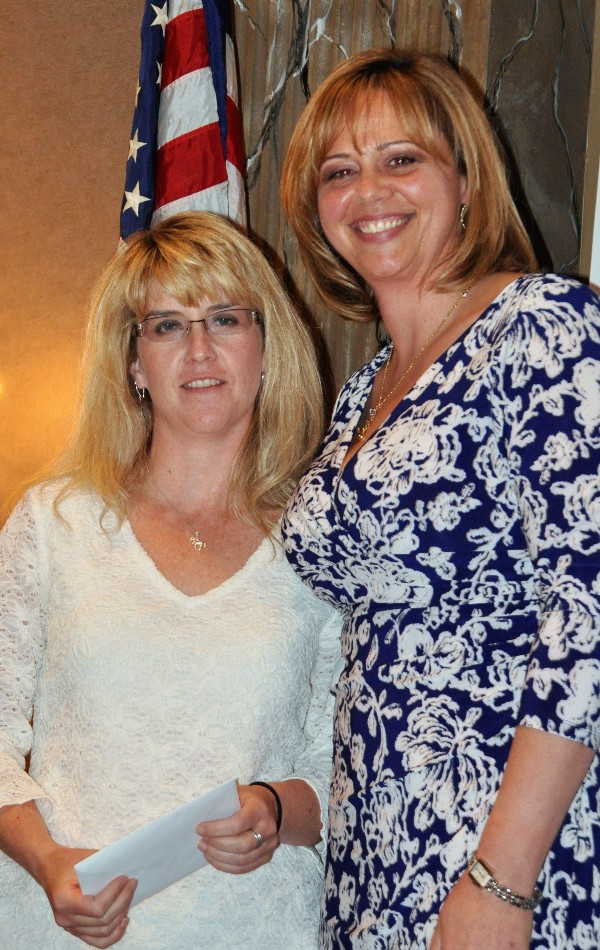 In April, Jennifer Kauffman (r), chapter president, recognizes Jen Jones, chapter treasurer, from Praxis Engineering, for her years of service in her role.