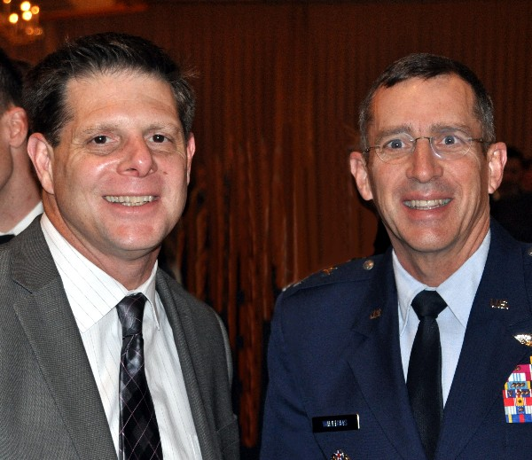 Joe Pacileo, ManTech, speaks with Maj. Gen. Brett T. Williams, USAF, director of operations, J-3, U.S. Cyber Command, following the general's speech at the March luncheon.