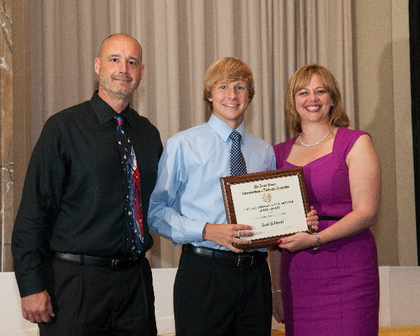 In May, Dr. Robert Young (l), cybersecurity and information technology specialist, Defense Information Assurance Program, Office of the Secretary of Defense, and Jennifer Kauffman, chapter president, present an award to Karl Schmidt, Mount Hebron High School, recipient of a $10,000 four-year scholarship.