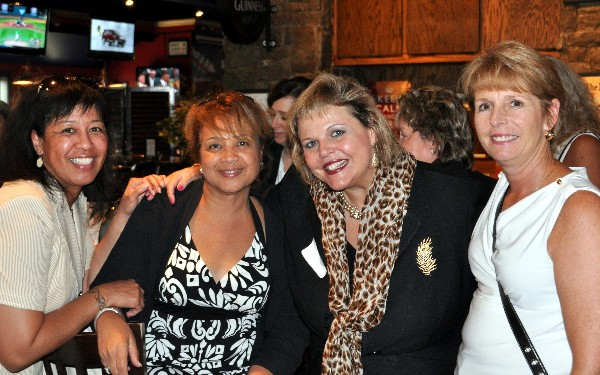 In August, (l-r) Jackie Andrews, Marjorie Forbes, Dilly and Doreen Harwood take a break from networking at the WIIG Social sponsored by Lockheed Martin.