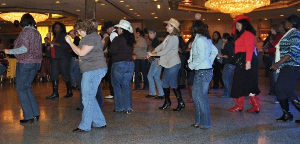 At the November fundraiser, chapter members, guests and volunteers enjoy a little line dancing.