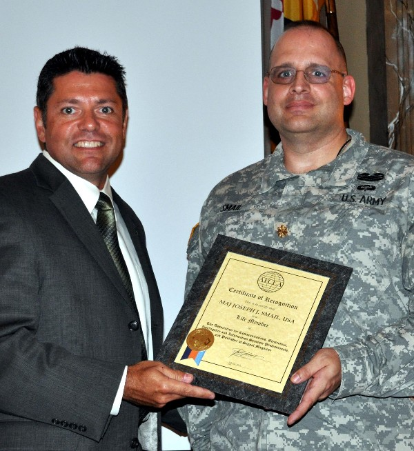 In September, Grimes (r) presents a Lifetime Membership Award to Maj. Joseph Smail, USA.
