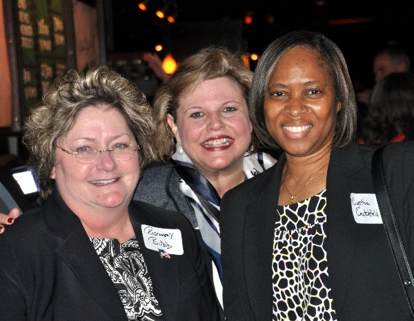 Rosemary Budd (l), director, strategic programs, Lockheed Martin IS&GS National; Colleen Dilly (c), AEITS, WIIG lead; and Cynthia Crutchfield, vice president, OCEUS Networks, gathering at the networking event in March.