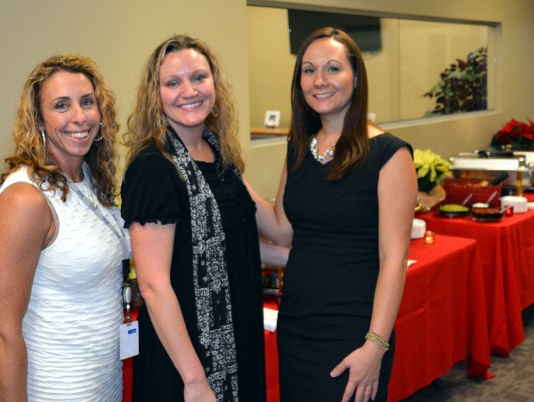 Together at the Women in Intelligence Group (WIIG) Holiday Social in December are (l-r) Jacky Kimmel, Annie Kimmel and Erin Horton from InfoTek, the event sponsor.