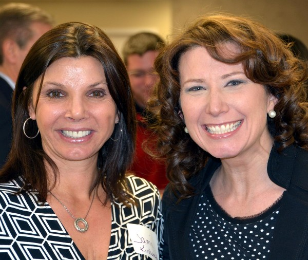 Jami Kirkwood (l) and Margot Blackard enjoying their time at the Women in Intelligence Group social in February.