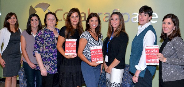 Members of the chapter�s Women In Intelligence Group (WIIG) enjoy reading Crucial Conversations: Tools for Talking When the Stakes Are High in September. Photo courtesy of John Garcia.