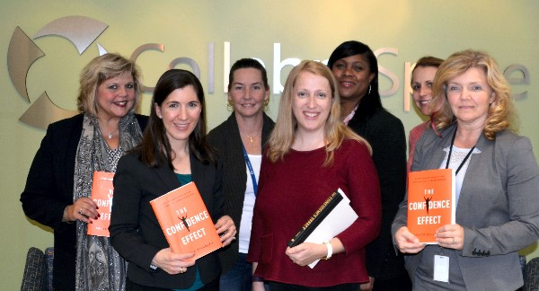 Members of the chapter's Women In Intelligence Group Book Club meet in October to discuss The Confidence Effect: Every Woman's Guide to the Attitude that Attracts Success.