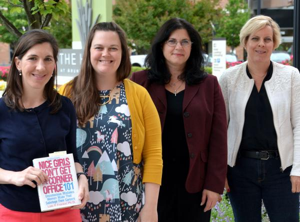 Attending the chapter's Women In Intelligence Group book club in May are (l-r) Kirsten Miller, Laurian Vega, Barbara Petilli and Jen Buchanan. Photo courtesy of John Garcia.