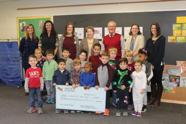 Indian Creek Lower School accepts their STEM grant from the chapter in December.