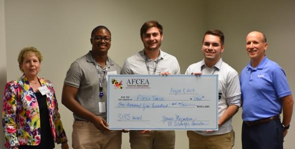 Jessica Morgenstern (l) and Gary Rosen (r) present the Best Presentation award to Colin Mason, Jake Gluck and Michael Chirico (l-r in the middle) at the Summer Intern Presentation Showcase in August.