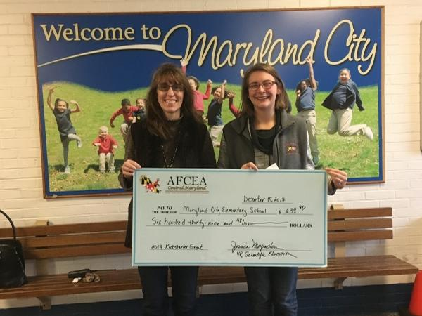 In December, teachers Laura Cooke (l) and Carly Legg Wood accept their first STEM grant from the chapter for Maryland City Elementary School.